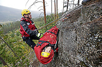 "Norwegian Air Ambulance training mountain rescue. A rescue paramedic is hoisted up with a ""patient"" during a session at Torpomoen training center."