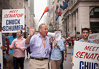 U.S. Senator Charles Schumer, with his obligatory bullhorn in the annual Lesbian, Gay, Bisexual and Transgender Pride Parade on Fifth Avenue in New York on Sunday, June 28, 2015. (© Richard B. Levine)
