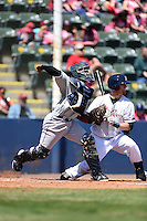 Mobile BayBears catcher Raywilly Gomez (15) throws down to second as Greg Hopkins (6) gets out of the way during a game against the Huntsville Stars on April 23, 2014 at Joe Davis Stadium in Huntsville, Tennessee.  Huntsville defeated Mobile 4-1.  (Mike Janes/Four Seam Images)