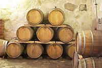 Oak barrels stacked in the wine cellar. Matusko Winery. Potmje village, Dingac wine region, Peljesac peninsula. Matusko Winery. Dingac village and region. Peljesac peninsula. Dalmatian Coast, Croatia, Europe.