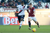 12th January 2020; Olympic Grande Torino Stadium, Turin, Piedmont, Italy; Serie A Football, Torino versus Bologna; Ibrahima Mbaye of Bologna FC challenges Andrea Belotti of Torino FC - Editorial Use