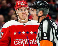 WASHINGTON, DC - JANUARY 31: T.J. Oshie #77 of the Washington Capitals talks to referee Chris Rooney #5 during a game between New York Islanders and Washington Capitals at Capital One Arena on January 31, 2020 in Washington, DC.