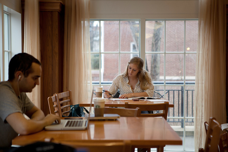 Students Daniel J. Hildebrand (Left) and Stefani Craze study in The Front Room in Baker Center.