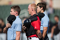 Kannapolis Intimidators catcher Casey Schroeder (center) stands for the National Anthem with home plate umpire Sam Burch (left) and first base umpire Zach Neff (right) prior to the game against the Delmarva Shorebirds at Kannapolis Intimidators Stadium on July 2, 2017 in Kannapolis, North Carolina.  The Shorebirds defeated the Intimidators 5-4.  (Brian Westerholt/Four Seam Images)