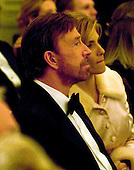 Washington, D.C. - February 14, 2006 -- Actor Chuck Norris and unidentified guest watch as Michael Feinstein performs for United States President George W. Bush and first lady Laura Bush and their guests at a Valentine's Day Social Dinner in the East Room of the White House in Washington, D.C. on February 14, 2006.<br /> Credit: Ron Sachs / CNP
