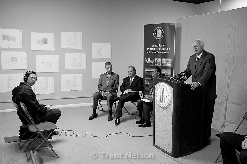 Gordon Walker, Director of the State Department of Housing and Community Development, speaks  at a press conference announcing the redevelopment of old tenement buildings at 251 S State Street in Salt Lake City, Utah, Tuesday, November 29, 2011. Seated next to Walker are, left to right, Grant Whittaker, Utah Housing Corporation, Ben Logue, The La Porte Group, and Rick Garcia, the HUD Region VIII Regional Administrator.