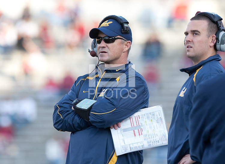 Head Coach Jeff Tedford and son Taylor Tedford watch the play. The University of California football defeated Washington State University 20-13 at Martin Stadium in Pullman, Washington on November 6th, 2010.
