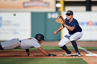 Lakeland Flying Tigers first baseman Blaise Salter (21) receives a pick off throw as Tyler Gaffney (6) dives back towards the base during the first game of a doubleheader against the Bradenton Marauders on April 11, 2018 at Publix Field at Joker Marchant Stadium in Lakeland, Florida.  Lakeland defeated Bradenton 5-4.  (Mike Janes/Four Seam Images)