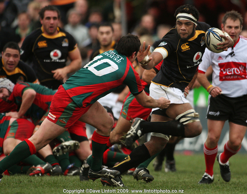 Wellington lock Api Naikatini fends off Byron Karaitiana on his way to the tryline during the Ranfurly Shield rugby match between the Wellington Lions and Wairarapa Bush at Trust House Memorial Park, Masterton, New Zealand on Saturday, 27 September 2008. Photo: Dave Lintott / lintottphoto.co.nz