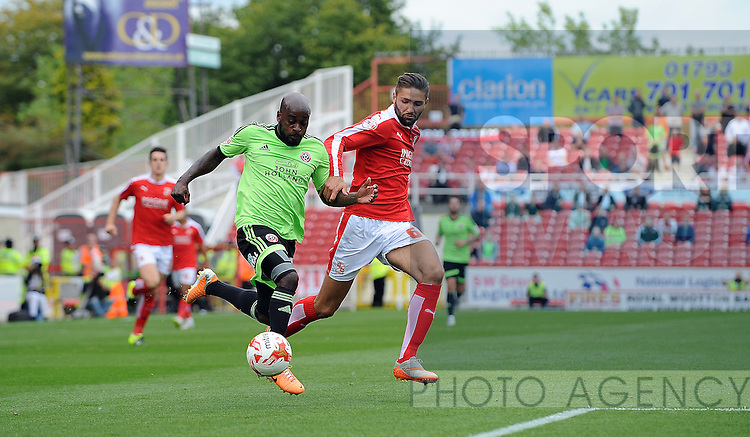 Jamal Campbell-Ryce of Sheffield United is challenged by Jordan Turnbull of Swindon Town<br /> - English League One - Swindon Town vs Sheffield Utd - County Ground Stadium - Swindon - England - 29th August 2015