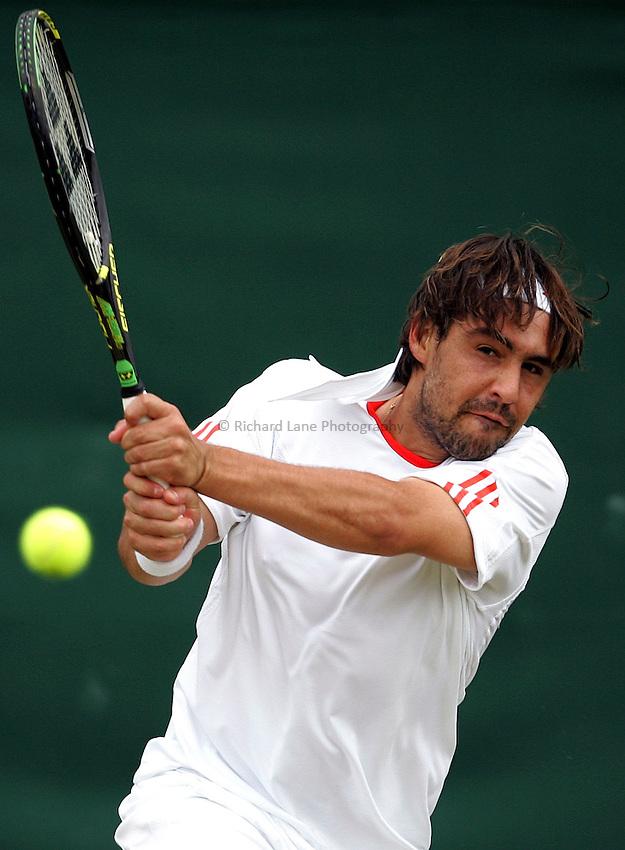 Photo: Paul Thomas..Wimbledon Championships. 05/07/2007...Marcos Baghdatis (CYP) in action against Nikolay Davydenko.