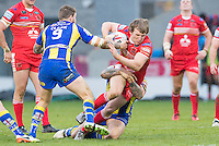 Picture by Allan McKenzie/SWpix.com - 04/03/2017 - Rugby League - Betfred Super League - Salford Red Devils v Warrington Wolves - AJ Bell Stadium, Salford, England - Salford's Logan Tomkins is tackled by Warrington.