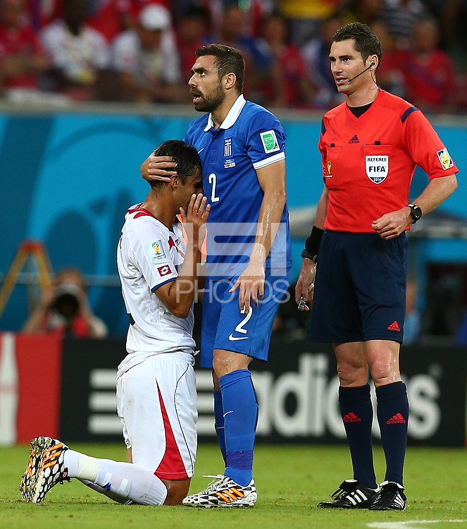 Ioannis Maniatis of Greece embraces Bryan Ruiz of Costa Rica after a foul