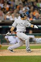 Melky Cabrera of the New York Yankees follows through on his swing against the Detroit Tigers at Comerica Park April 27, 2009 in Detroit, Michigan.  Photo by Brian Westerholt / Four Seam Images