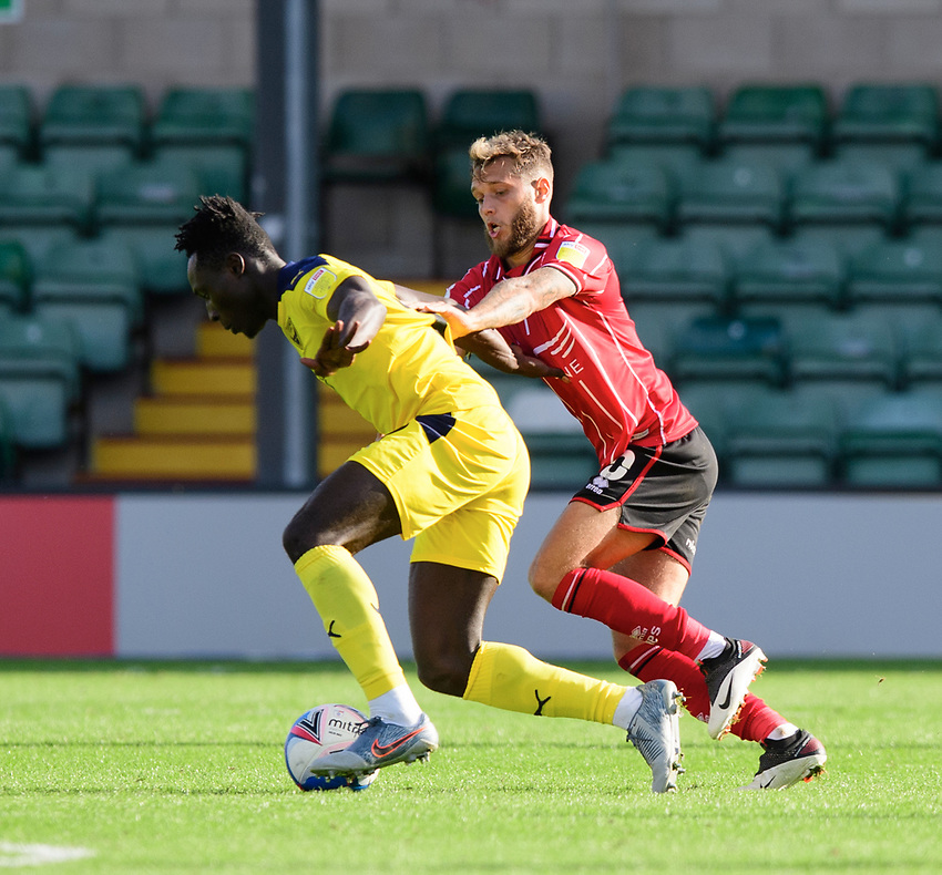 Lincoln City's Jorge Grant vies for possession with Oxford United's Daniel Agyei<br /> <br /> Photographer Chris Vaughan/CameraSport<br /> <br /> The EFL Sky Bet League One - Saturday 12th September 2020 - Lincoln City v Oxford United - LNER Stadium - Lincoln<br /> <br /> World Copyright © 2020 CameraSport. All rights reserved. 43 Linden Ave. Countesthorpe. Leicester. England. LE8 5PG - Tel: +44 (0) 116 277 4147 - admin@camerasport.com - www.camerasport.com - Lincoln City v Oxford United