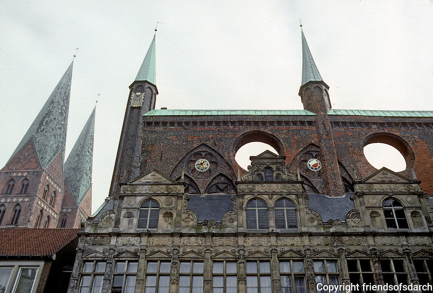 Lubeck: An ensemble--the spires of the 14th C. Marienkirche at left; high walls of 15th C. Rathaus; and Renaissance limestone wall. Photo '87.