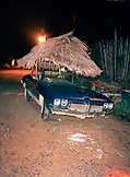 PANAMA, Bocas del Toro, a car with a thatched palapa roof