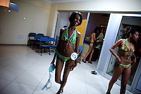 A contender for the crown walks out of an improvised changing room during the 2009 MIss Ethiopia beauty pageant held at the Intercontinental Hotel in Ethiopia's Capital Addis Ababa on Sunday January 18 2009.