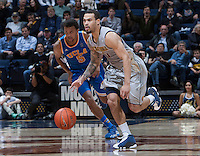 Justin Cobbs of California dribbles the ball during the game against UCLA at Haas Pavilion in Berkeley, California on February 19th, 2014.  UCLA defeated California, 86-66.