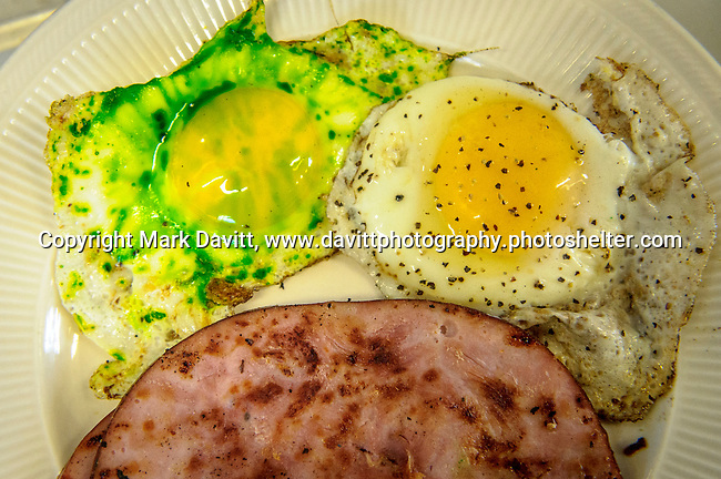 Founder's Irish Pub held its annual St. Patricks Day Kegs and Eggs featuring green eggs and ham and green beer in Bondurant March 17. Of course the eggs start out normal. Then... chef Jason Day starts his magical greening. Finally there is the full presentation of green eggs and ham.