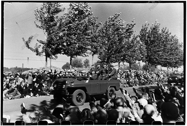 The procession following Mao's jeep carry his would-be successor, Vice-Chairman Marshal Lin Biao, Premier Zhou Enlai (shown here), and Mao's wife, Jiang Qing. Beijing, 18 October 1966