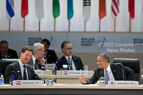 "United States President Barack Obama, right, speaks to Mark Rutte, Dutch prime minister, during an opening plenary entitled ""National Actions to Enhance Nuclear Security"" at the Nuclear Security Summit in Washington, D.C., U.S., on Friday, April 1, 2016. After a spate of terrorist attacks from Europe to Africa, Obama is rallying international support during the summit for an effort to keep Islamic State and similar groups from obtaining nuclear material and other weapons of mass destruction. <br /> Credit: Andrew Harrer / Pool via CNP"