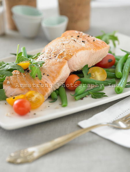 King salmon filet with green beans, arugula, and cherry tomatoes