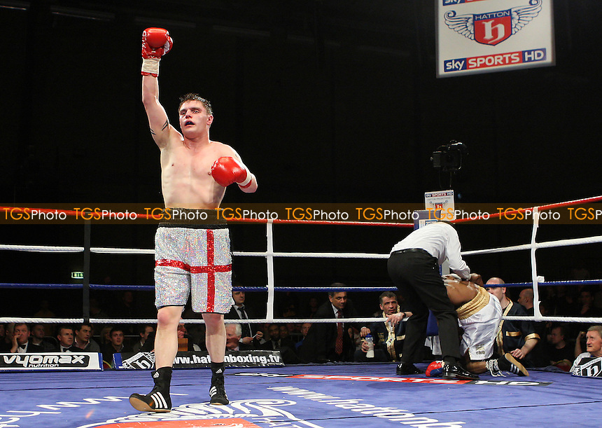Daryl Setterfield (silver shorts) defeats Darren Hamilton in a Light-Welterweight boxing contest at Goresbrook Leisure Centre, Dagenham promoted by Ricky Hatton -  26/03/10 - MANDATORY CREDIT: Gavin Ellis/TGSPHOTO - Self billing applies where appropriate - Tel: 0845 094 6026