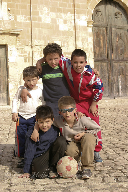 Group of Sicilian boys with soccer ball. Italy