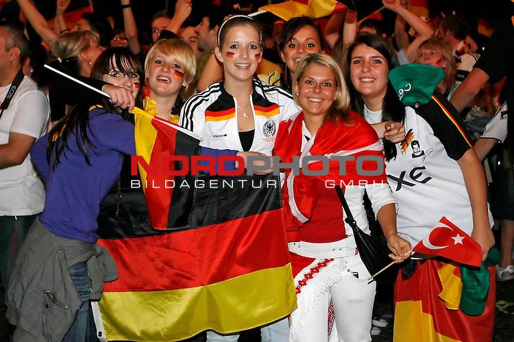 UEFA Euro 2008 1/2 Finale Fanmeile Bremen Match 29 <br /> Halffinal - Halbfinale<br /> Deutschland (GER) - TŁrkei (TUR) 3:2 (1:1)<br /> Germany vs. Turkey<br /> <br /> Fanmeile und Public Viewing in Bremen.<br /> Deutsche und TŁrkische Fansfrauen nach dem Spiel vereint am feiern.<br /> <br /> Foto &copy; nph (  nordphoto  ) *** Local Caption ***