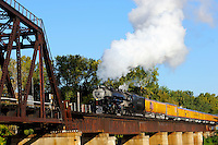 Union Pacific Railroad's Challenger steam engine 3895 pulls a passenger train across the Minnesota River in St. Paul Minnesota.