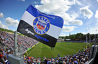A general view of a Bath Rugby flag flying above the terracing. Aviva Premiership semi-final, between Bath Rugby and Leicester Tigers on May 23, 2015 at the Recreation Ground in Bath, England. Photo by: Patrick Khachfe / Onside Images