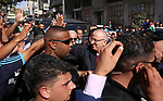 (FILES) In this file photo taken on October 2, 2017 shows Palestinian Prime Minister Rami Hamdallah waves during his visit to the Shejaiya neighborhood in Gaza City. An explosion has struck the convoy of Palestinian Prime Minister Rami Hamdallah upon his entrance into the Gaza Strip on Tuesday March 13, 2018 lightly injuring several people. The explosive device detonated shortly after Hamdallah and his convoy passed through the Beit Hanoun checkpoint with Israel in northern Gaza. Photo by Yasser Qudih