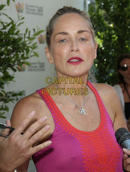 Sharon Stone.Elizabeth Glaser Pediatric AIDS Foundation's 23rd Annual 'A Time For Heroes' Celebrity Picnic held at The Wadsworth Theater, Los Angeles, California, USA..3rd June 2012.headshot portrait pink red hand.CAP/ADM/FS.©Faye Sadou/AdMedia/Capital Pictures.