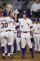 LSU Tigers first base Mason Katz #8 greets teammate Alex Bregman #30 after he scores against the Auburn Tigers in the NCAA baseball game on March 22nd, 2013 at Alex Box Stadium in Baton Rouge, Louisiana. LSU defeated Auburn 9-4. (Andrew Woolley/Four Seam Images)