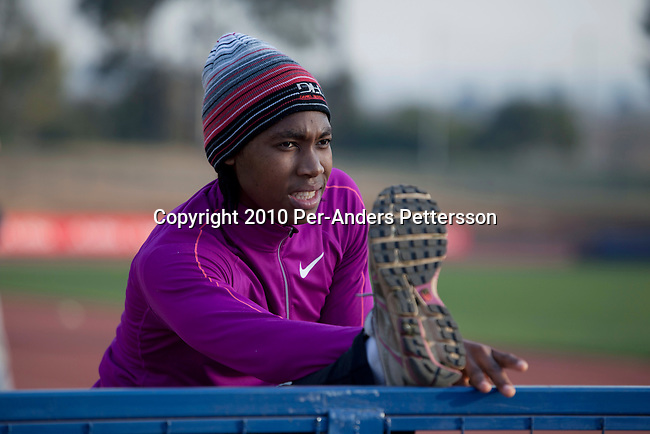 PRETORIA, SOUTH AFRICA - AUGUST 10: Caster Semenya, age 19, warms up before a training at the High Performance Center at the university of Pretoria on August 10, 2010 in Pretoria, South Africa. Caster Semenya won the 800 meters world championship gold medal in Berlin in 2009 was recently cleared to run after her career was held back due to gender testing. She grew up in a rural village in Limpopo, northern South Africa, and she started running only a few years ago, and quickly appeared from nowhere to the world stage. After being banned for almost a year she was cleared by the IAAF and cleared to compete in July 2010. (Photo by Per-Anders Pettersson/Getty Images)