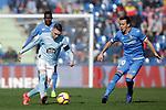 Getafe CF's Djene Dakoman (L) and Nemanja Maksimovic (R)  and Celta de Vigo's Iago Aspas  during La Liga match. February 09,2019. (ALTERPHOTOS/Alconada)