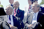 Washington, D.C. - May 29, 2004 -- United States Secretary of State Colin Powell, left, and United States Secretary of Defense Donald Rumsfeld, right, listen as President George W. Bush makes remarks at the dedication of the World War Two Memorial in Washington, D.C. on May 29, 2004..Credit: Ron Sachs / CNP