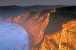 Golden sunrise light on steep coastal cliffs Drakes Bay Point Reyes National Seashore Marin California Sunrise light on coastal cliffs above Drakes Bay, Point Reyes National Seashore, Marin County, California