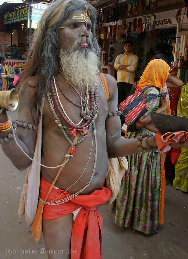 sadhu with shiva fork stuck in tongue in holy city Pushkar, Rajastan, India. Time of  Kartik Purnima (eight full moon of the year), where devotees  bath in Pushkars sacred lake