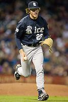 Ryan Berry #28 of the Rice Owls jogs the ball towards first base versus the Texas A&M Aggies in the 2009 Houston College Classic at Minute Maid Park February 28, 2009 in Houston, TX.  The Owls defeated the Aggies 2-0. (Photo by Brian Westerholt / Four Seam Images)