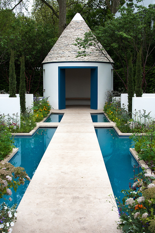 RBC Blue Water Garden, designed by Nigel Dunnett, RHS Chelsea Flower Show 2012. The pavilion is based on the design of traditional Trulli buildings in Puglia, Italy.