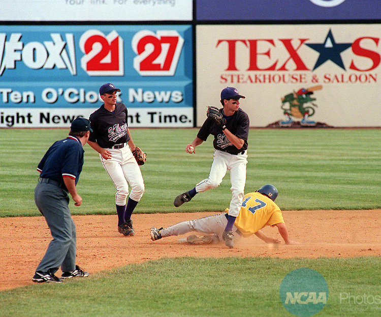 01 JUNE 1999:  St. Thomas secondbaseman Jake Mauer (12) looks to make a double play during the Men's Division III Baseball Championship held at the Salem Memorial Baseball Stadium in Salem, VA. St. Thomas lost to NC Wesleyan 1-0 in the championship game. Andres Alonso/NCAA Photos.