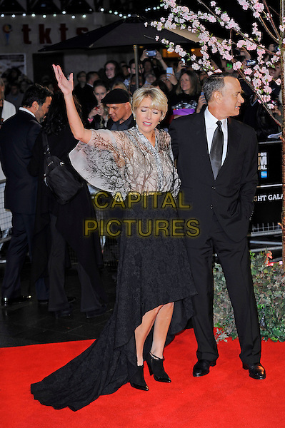 Emma Thompson and Tom Hanks<br /> attending the 57th BFI London Film Festival Closing Night Gala World Premiere of 'Saving Mr Banks', Odeon Cinema, Leicester Square, London, England. <br /> 20th October 2013<br /> full length black suit tie white shirt skirt train beige white pattern blouse top profile hand arm in air waving eyes funny closed <br /> CAP/MAR<br /> &copy; Martin Harris/Capital Pictures