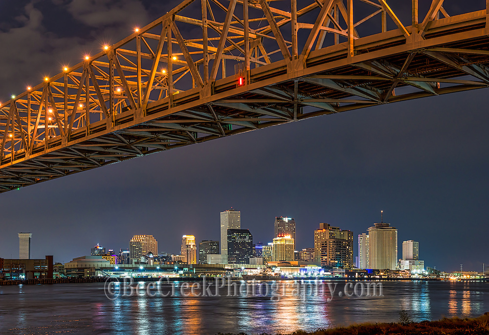 Mississippi river bridges with the skyline of New Orleans in view.