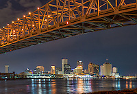 Mississippi river bridges with the skyline of New Orleans in view under the Cresent city  Connections. .
