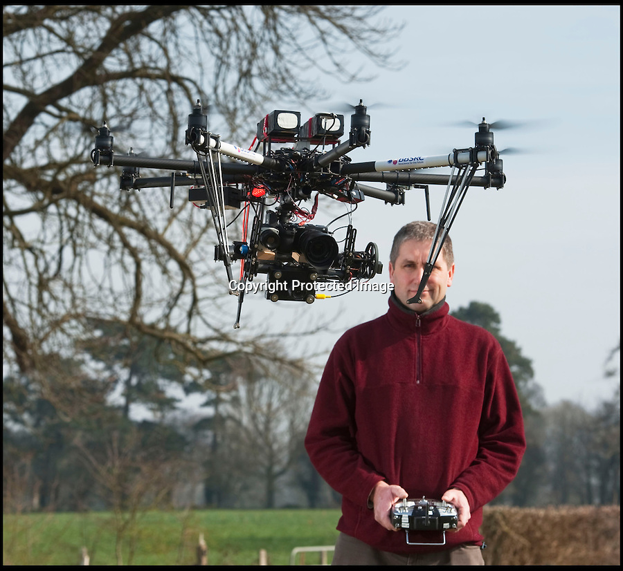 BNPS.co.uk (01202 558833)<br /> Pic: PhilYeomans/BNPS<br /> <br /> Pilot Andrew Riche with the 'OctoCropter'<br /> <br /> Drone technolgy now reaches down to the farm.<br /> <br /> Plucky British scientists have come up with an ingenious way of surveying hundreds of acres of crops - by employing a 25,000 pounds drone helicopter used to film Hollywood movies.<br /> <br /> The cutting-edge custom-built gizmo, known as an octocopter, flies low over 800 acres of wheat fields taking measurements that help researchers better understand how crops grow.<br /> <br /> It can collect the same amount of information in a five-minute flight than a team of staff would collect in a day.<br /> <br /> A relatively recent invention, drone helicopters are more commonly seen on movie sets where they are used to film aerial shots.<br /> <br /> But the carbon fibre eight-rotor copter is now being put to work by boffins at Rothamsted Research, the longest running agricultural research station in the world.