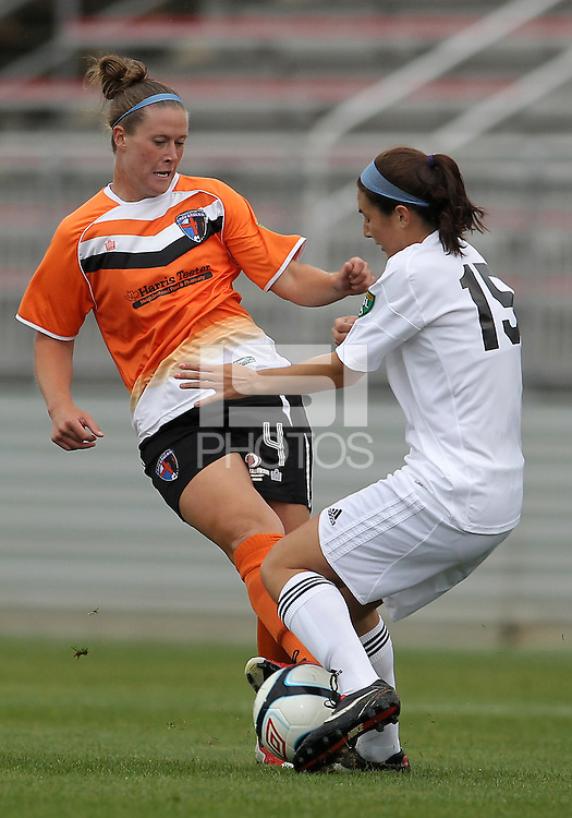 BOYDS, MARYLAND - July 21, 2012:  Amanda Naeher (4) of Charlotte Lady Eagles clashes with Molly Bruh (19) of the Long Island Roughriders during a W League Eastern Conference Championship semi final match at Maryland Soccerplex, in Boyds, Maryland on July 21.