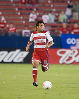FC Dallas midfielder Arturo Alvarez (12) advances the ball.  New England Revolution defeated FC Dallas 3-2 to capture the 2007 Lamar Hunt U.S. Open Cup at Pizza Hut Park in Frisco, TX on October 3, 2007.