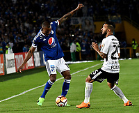 BOGOTA - COLOMBIA – 28 - 02 - 2018: Jair Palacios (Izq.) jugador de Millonarios (COL), disputan el balon con Clayson (Der.) jugador de Corinthians (BRA), durante partido entre Millonarios (COL) y Corinthians (BRA), de la fase de grupos, grupo 7, fecha 1 de la Copa Conmebol Libertadores 2018, en el estadio Nemesio Camacho El Campin, de la ciudad de Bogota. / Jair Palacios (L) player of Millonarios (COL), fights for the ball with Clayson (R) player of Corinthians (BRA), during a match between Millonarios (COL) and Corinthians (BRA), of the group stage, group 7, 1st date for the Conmebol Copa Libertadores 2018 in the Nemesio Camacho El Campin stadium in Bogota city. VizzorImage / Luis Ramirez / Staff.